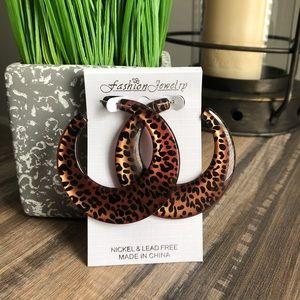 Leopard print earrings.